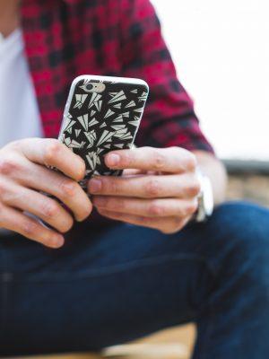 man-texting-iphone-closeup