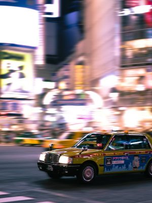 a-taxi-in-japan-hurtles-through-city-streets